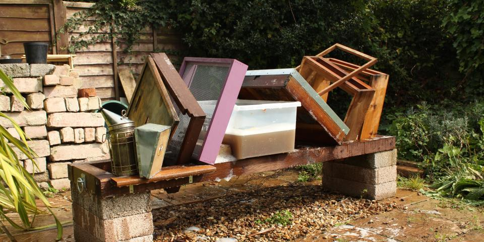 Beekeeping equipment being cleaned