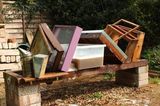 Beekeeping equipment being cleaned